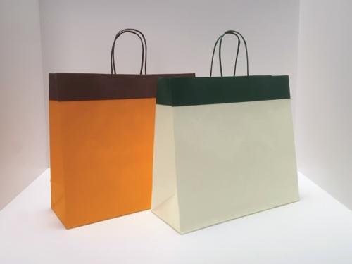 buste-shopper-carta-fondo-pieno-kraft-bianco-colorate-manico-maniglia-carta-ritorta-torciglione-bordo-piegato-piega-risvolto-risvoltato